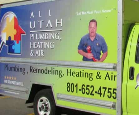 a blue and green plumbing service truck